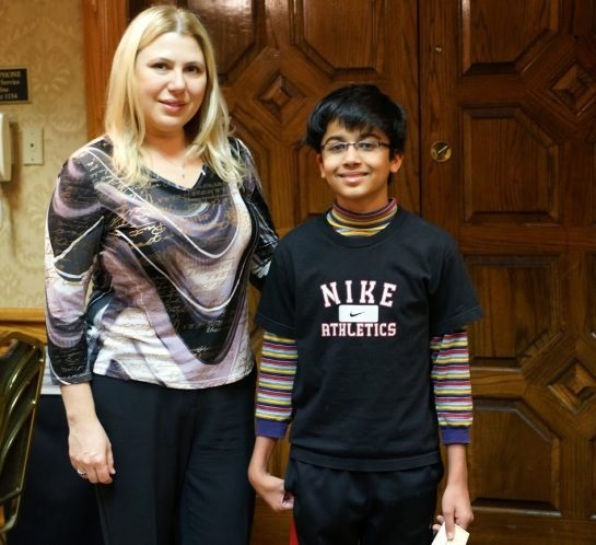 Akshat Chandra with Susan Polgar - receiving the co-winner U2400 prize at The Spice Cup - Oct 2013